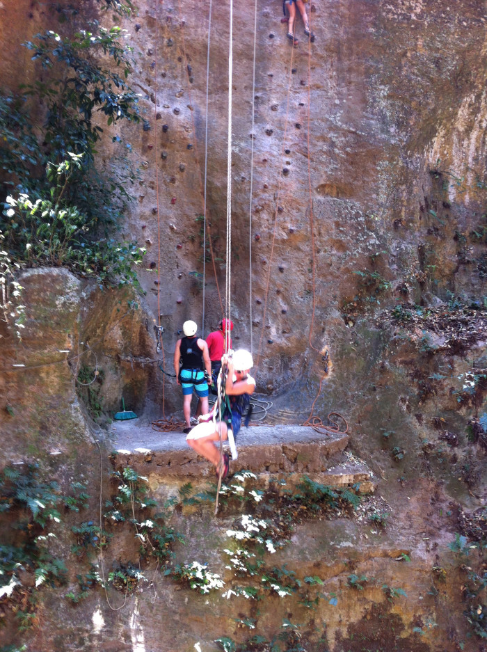 A thrill-seeker on Hacienda Guachipel'n's canopy tour does the Tarzan swing across the R'o Victoria, where a rock climb awaits.