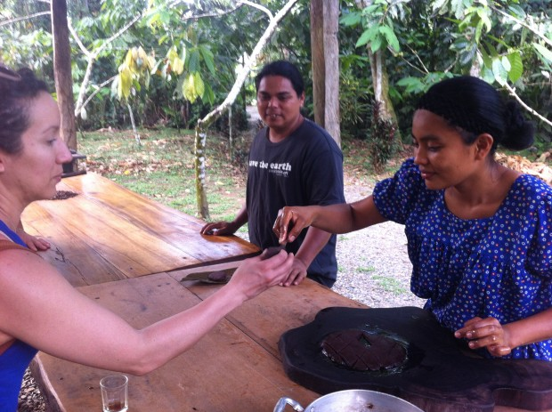 It's tasting time! Eunice hands a chocolate sample to Linda Ureña.