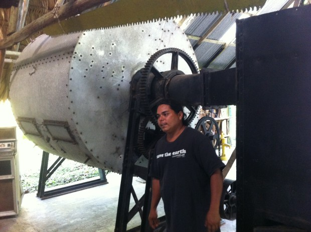 Rafael Obando explains some of the machinery brought in to mechanize the cocoa production process.