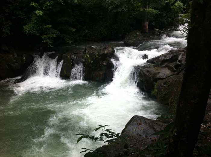 Waterfall and swimming hole just below the Rí'o La Fortuna Bridge.
