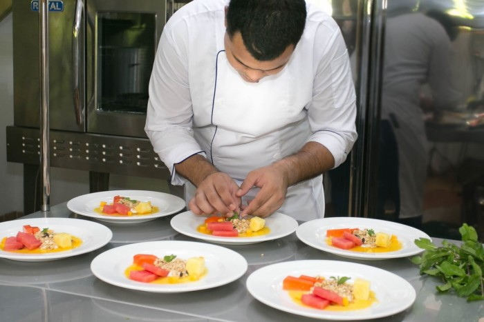 Chef Victor Castaneda prepares dishes at Playa Cativo Lodge.