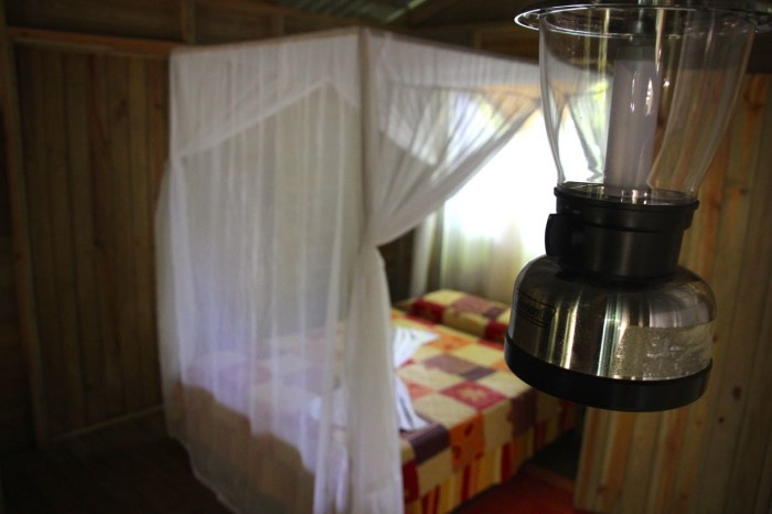 Rustic but comfy: Quilts and hanging lamps decorate the lodge's cabinas.
