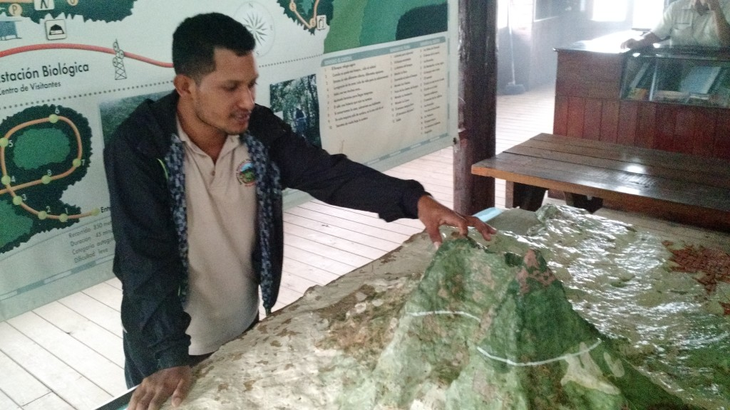Edwin Jirón points to a model of Mombacho, which reaches an altitude of 1,344 meters.