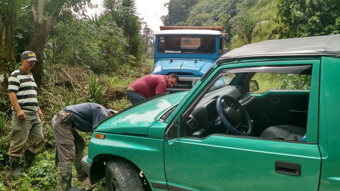 A group of farmers helps out a stuck Gringo.