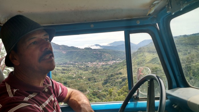 Enrique Navarro Sr. drives with the view of Santa María de Dota in the background.