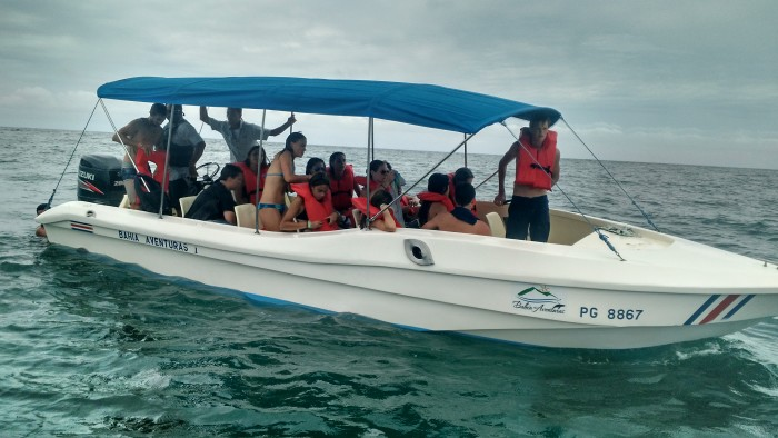 A Bahía Aventuras boat takes a group of U.S. students in search of whale and dolphin sightings.