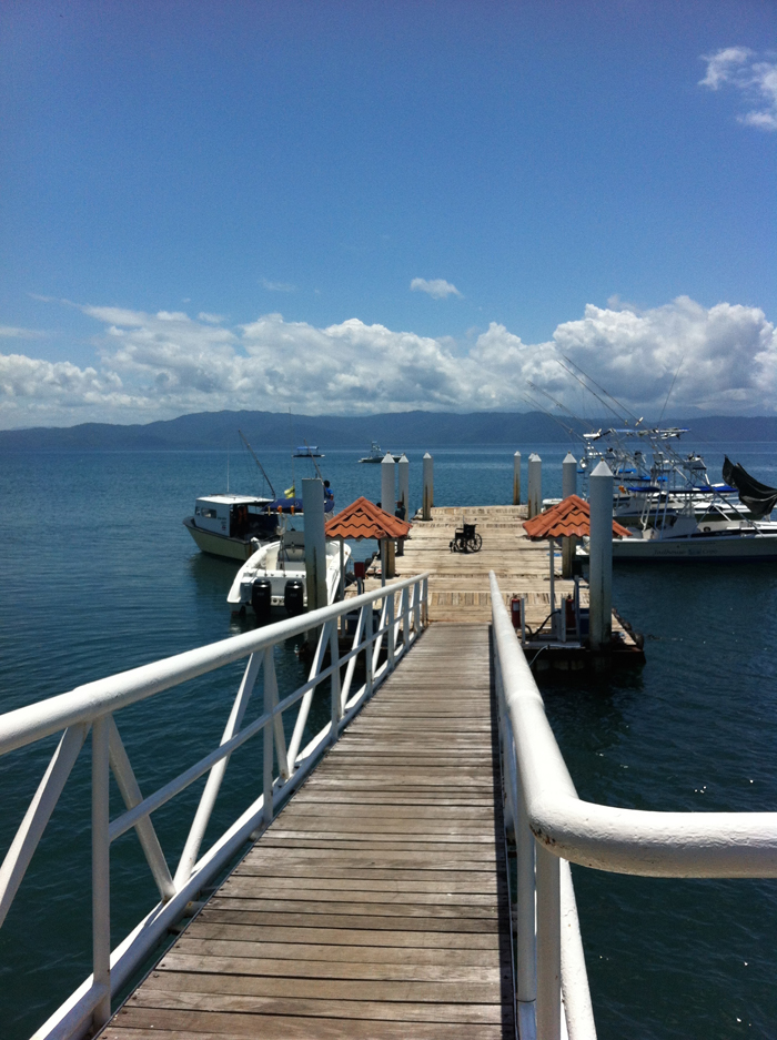 A wheelchair sits at the end of the Crocodile Bay pier after a woman was loaded onto a hospital boat.