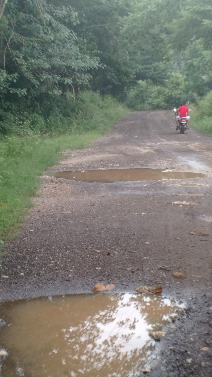 A motorcycle drives through one of the better sections of road cutting through the Nicoya Peninsula.
