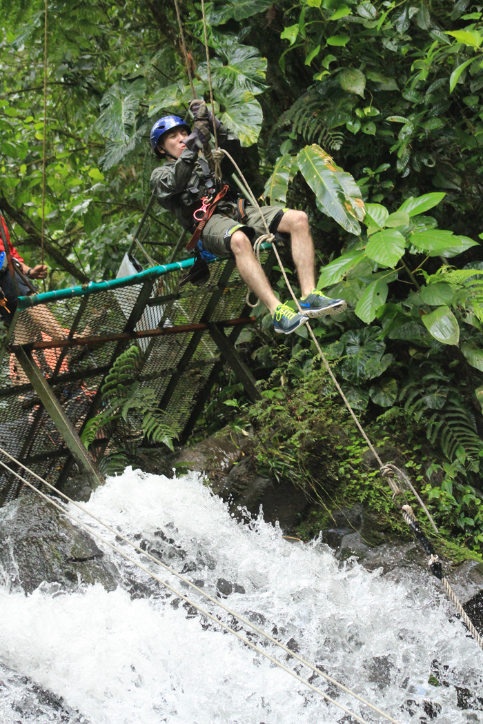 Nathan launches into flight on the waterfall Tarzan swing.