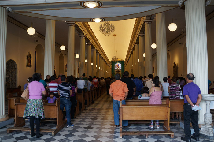 Churchgoers pack the pews at Iglesia Inmaculada Concepción de Heredia on a Sunday.