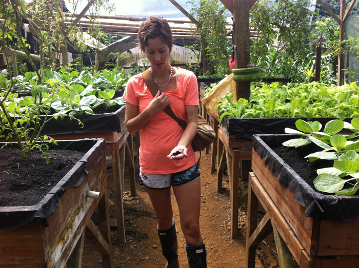 Erica Hogan in Finca Bellavista's impressive nursery/vegetable and herb garden.