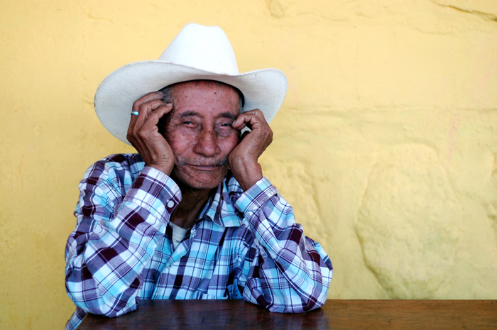 One of Konojel's elderly clients waits for lunch at the community center.