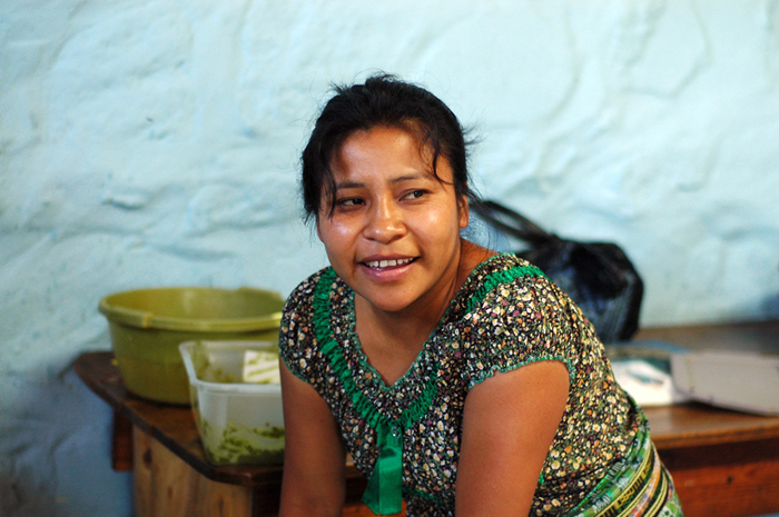 Elia, a 29-year-old mom, trains with the center's kitchen team.