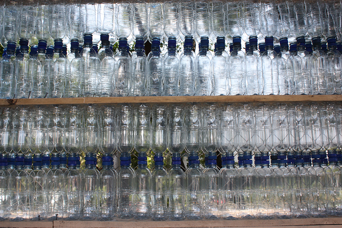 Construction materials for the bus stop include 1,600 recycled water bottles.