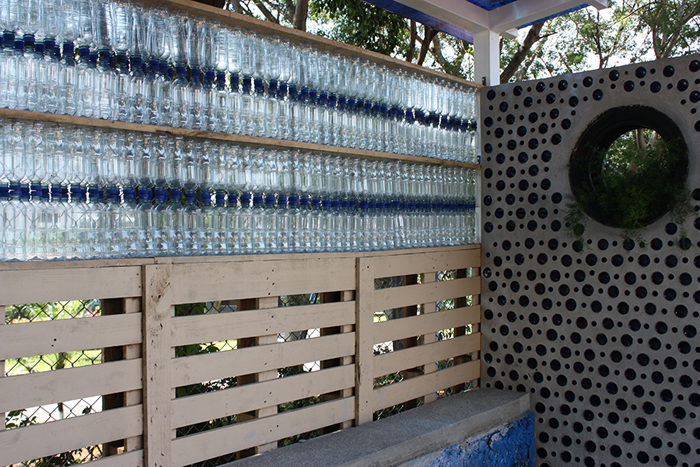 Water bottles, pallets, glass bottles and tires are among the materials used to build the bus stop.