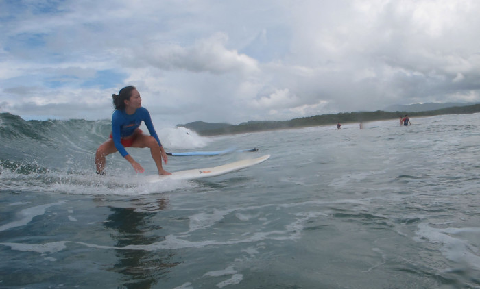 Van Ly catches a wave on Tamarindo Beach.