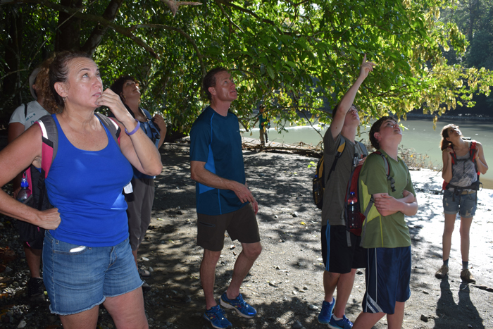 Monkey watchers: my friend Tricia McCormick, left, and our new friends check out some squirrel monkeys next to the Río Claro.