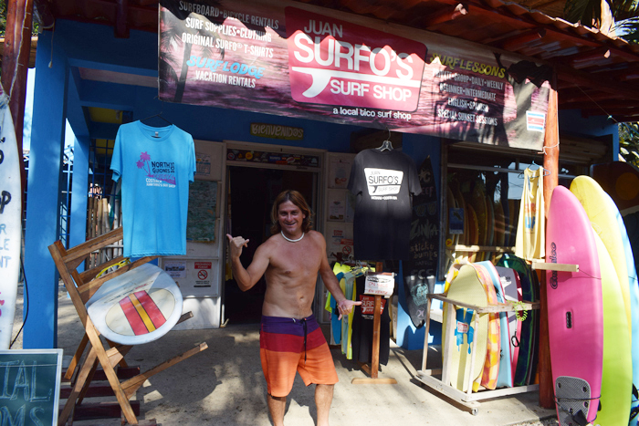 Juan Surfo in front of his shop.