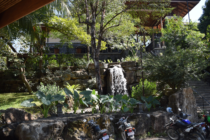 Waterfall and stairs at the entrance to the Bodhi Tree.