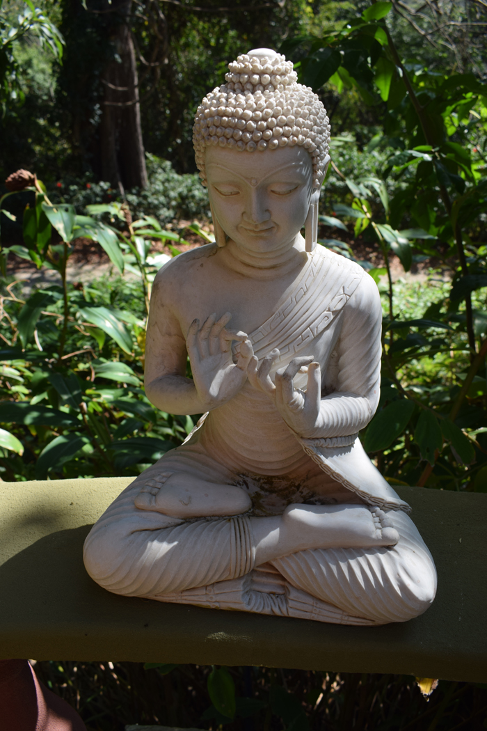 A cross-legged Buddha.