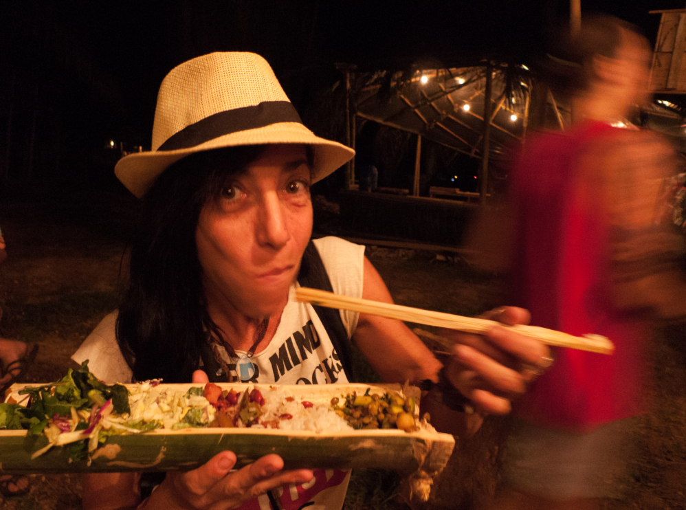 eating out of a bamboo trough at envision festival
