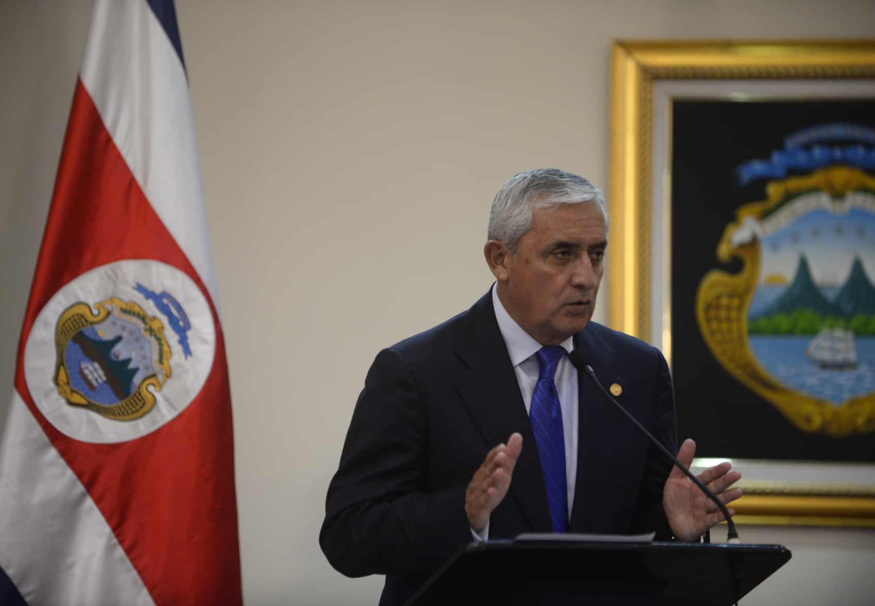 Guatemalan President Otto Pérez Molina addresses the press during his brief visit to Costa Rica on June 6, 2014.
