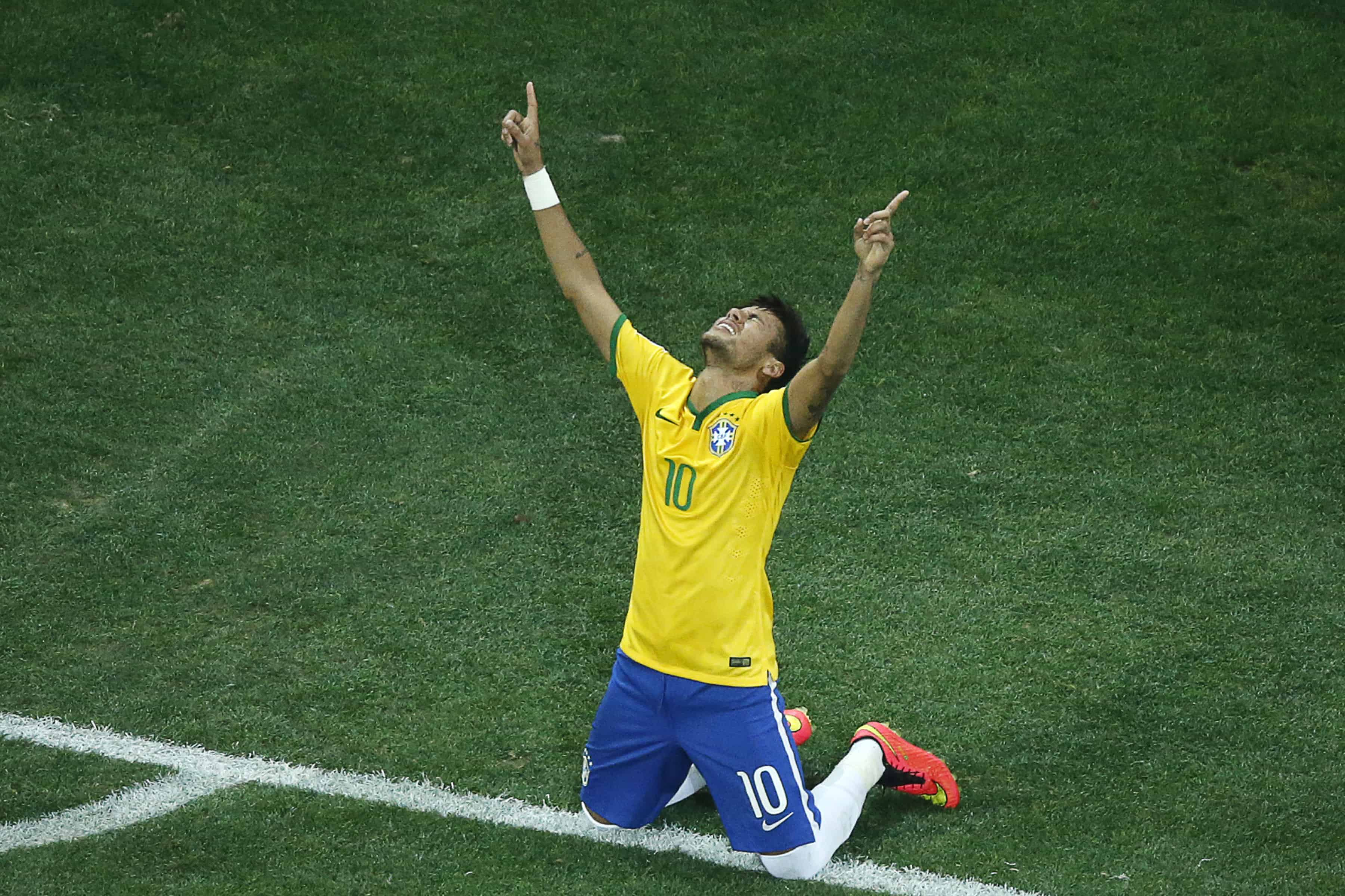 61d06cd8b Brazil s forward Neymar celebrates his second goal against Croatia during  the 2014 FIFA World Cup Group A football match at the Corinthians Arena in  São ...