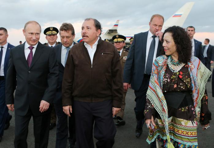 Russia President Vladimir Putin, left, walks with Nicaraguan President Daniel Ortega