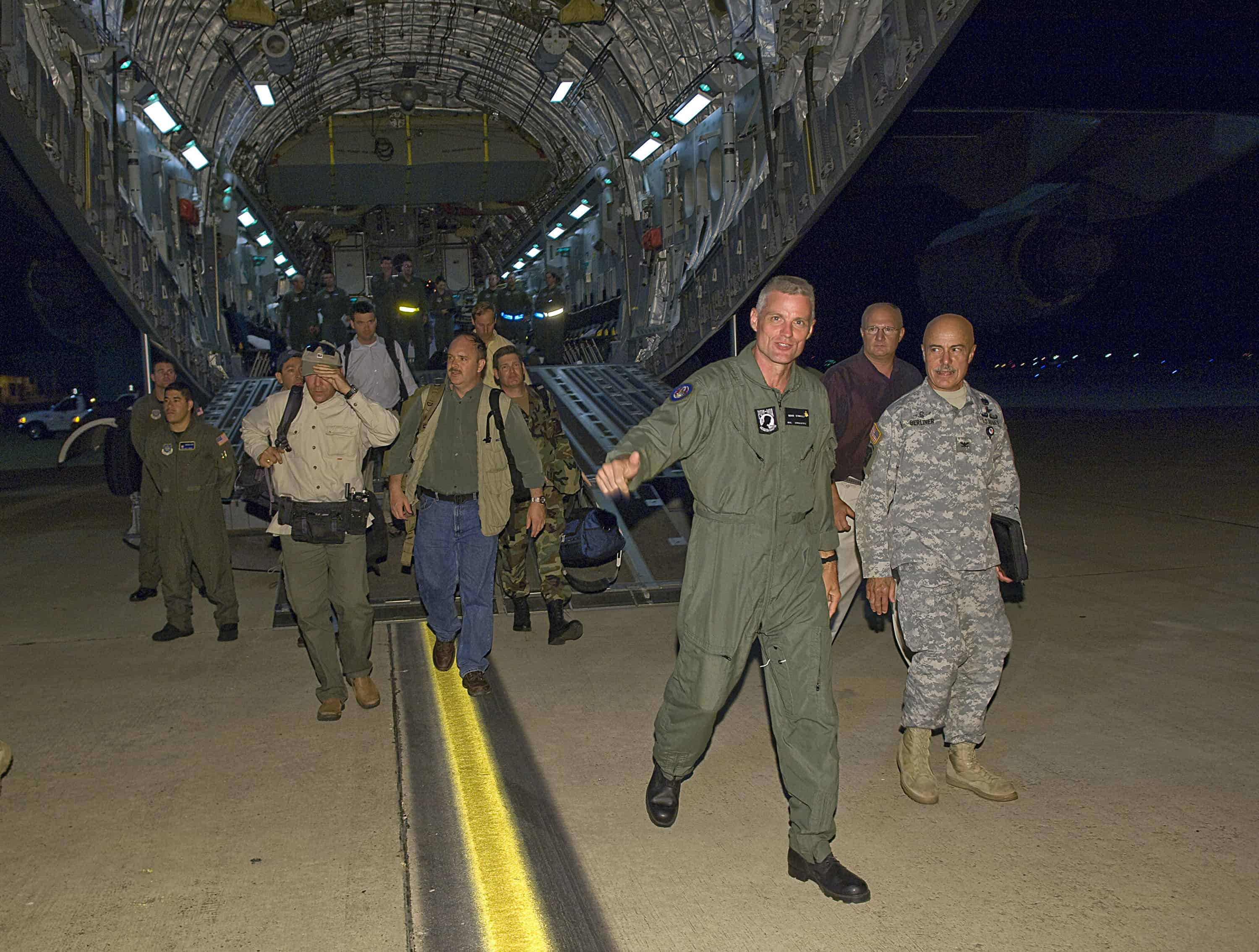 Former hostage Keith Stansell, center, exits a C-17 Globemaster III onto U.S. soil.