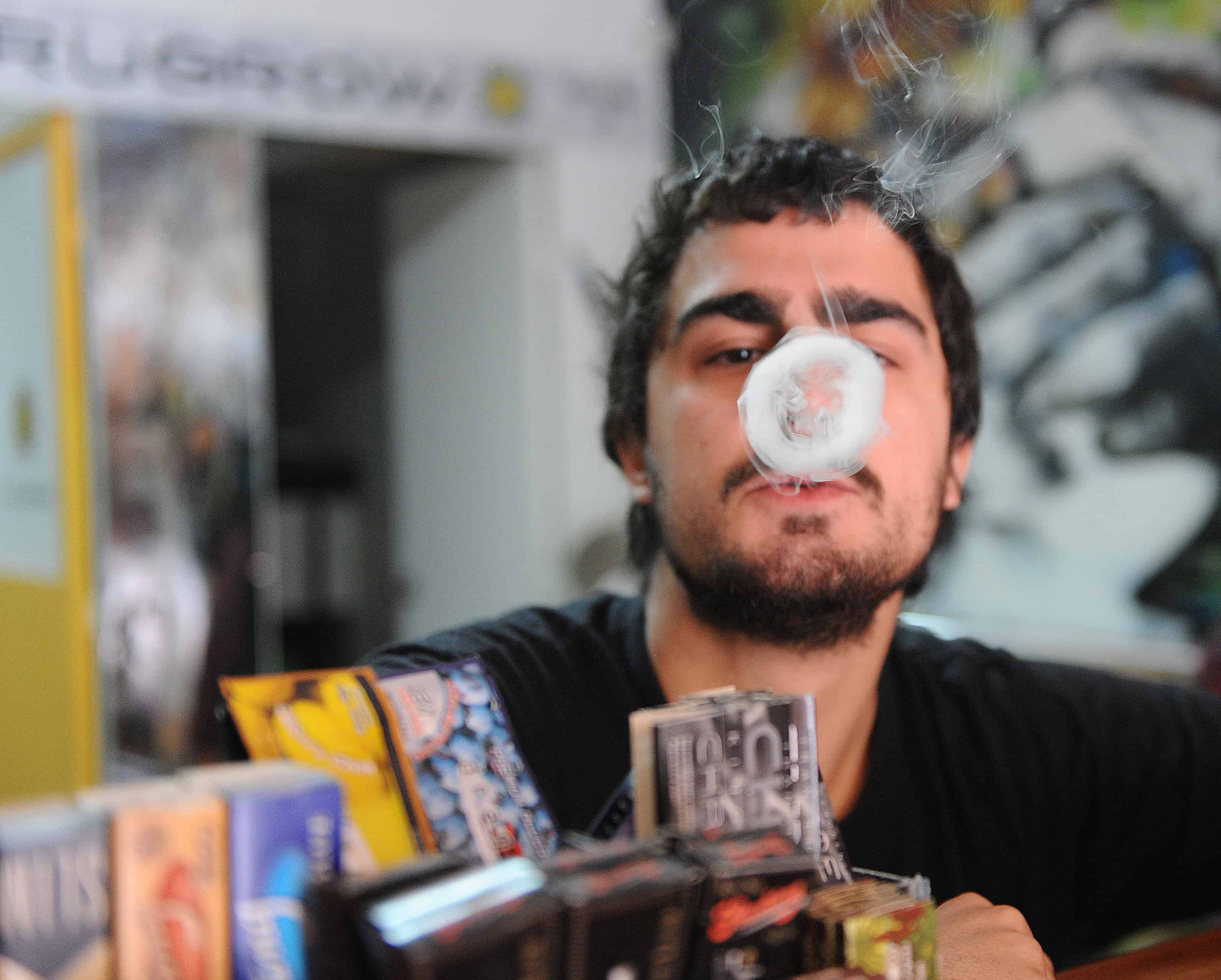 Juan Manuel, owner of the first shop dedicated to cannabis merchandising in Montevideo, Uruguay, smokes a joint on April 24, 2014.