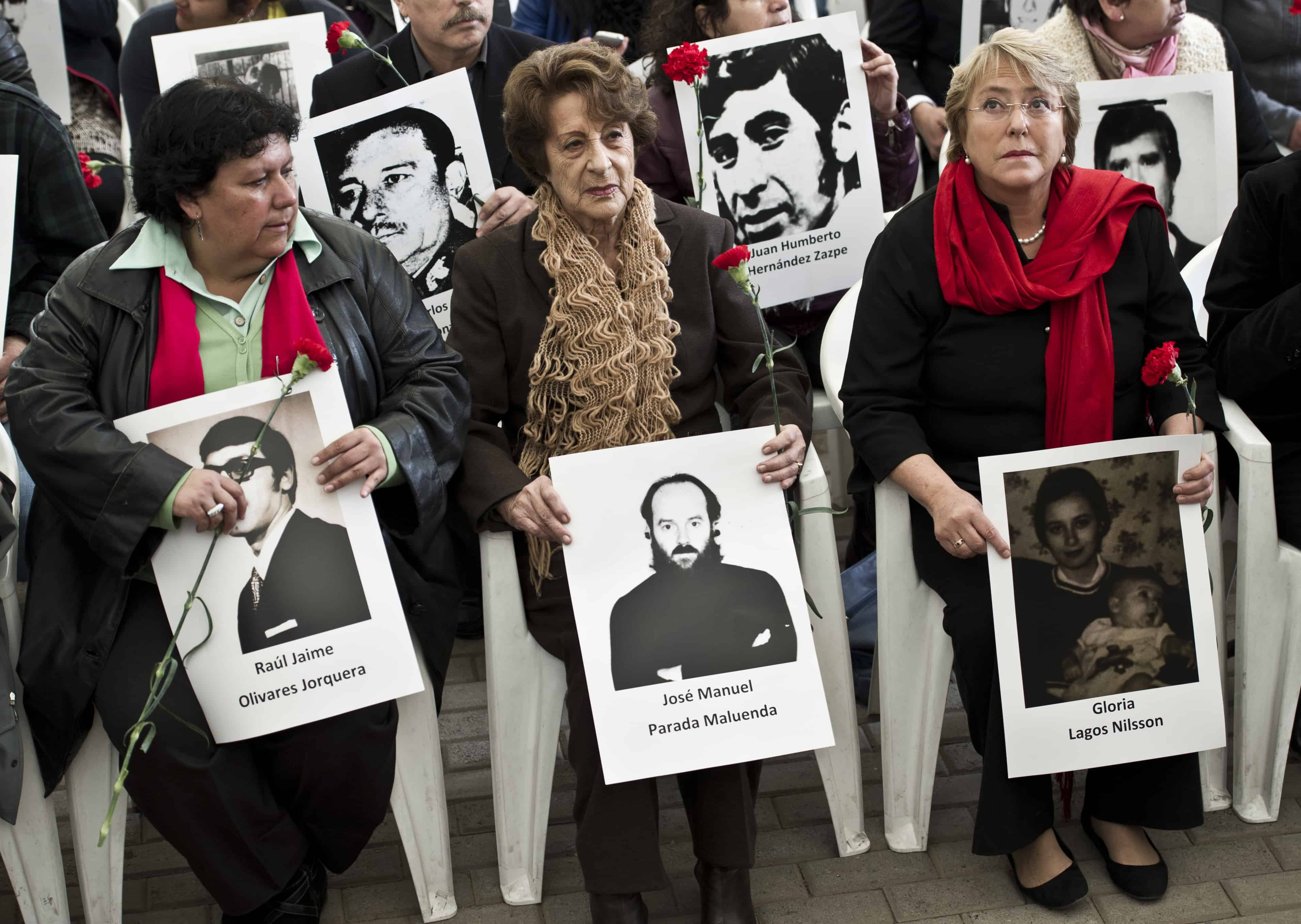 Chile's former President Michelle Bachelet, right, her mother Angela Jeria, center, and Lorena Pizarro, president of the Association of Relatives of the Detained and Disappeared, left, participate in a ceremony at Villa Grimaldi, which was used as a detention and torture center during the dictatorship of Augusto Pinochet, in Santiago, on Sept. 10, 2013.