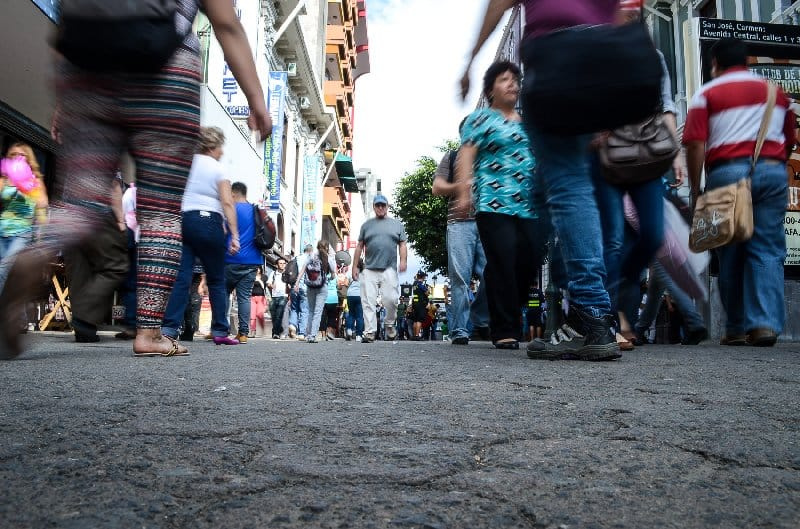 San José pedestrians walk Avenida Central.