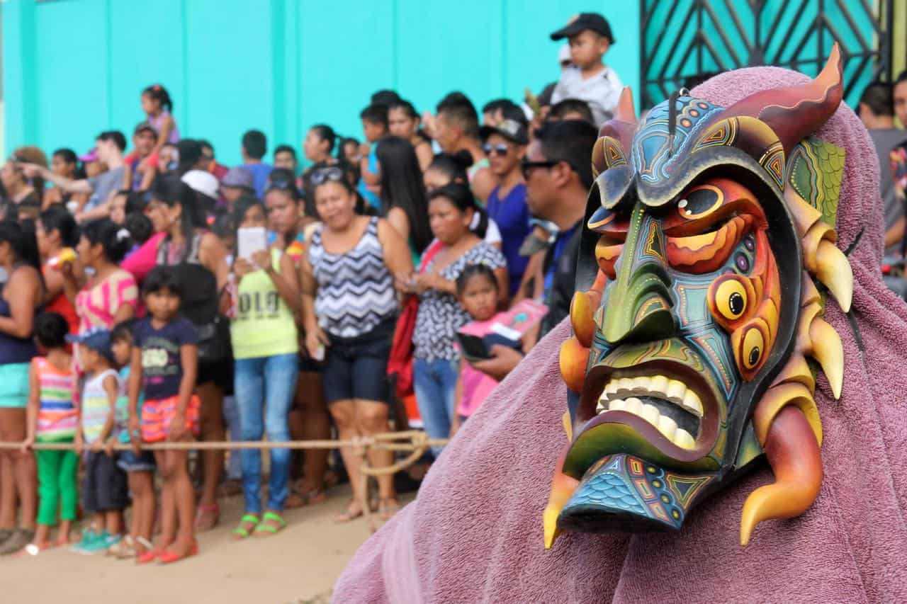 Person wearing Brunca mask and crowd