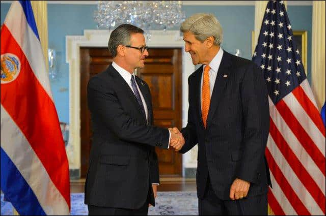 Costa Rican Foreign Minister Manuel Antonio González Sanz shakes hands with U.S. Secretary of State John F. Kerry