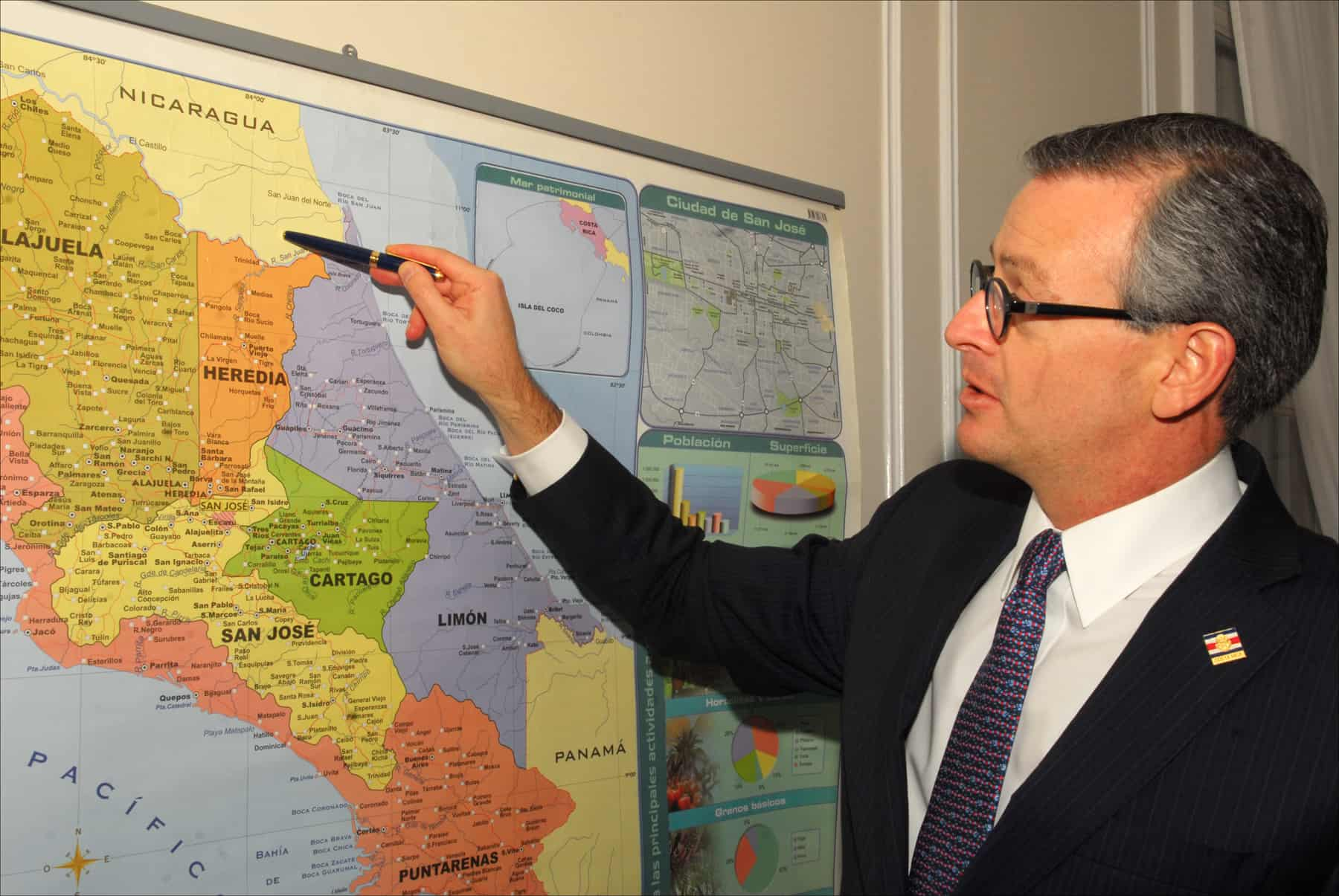 Costa Rican Foreign Minister Manuel González points to his country's disputed border with Nicaragua