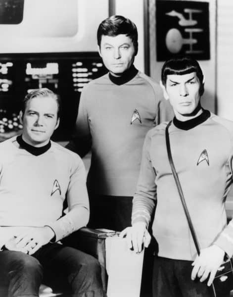 """William Shatner, left, DeForest Kelley, center, and Leonard Nimoy pose on the set of the television series """"Star Trek"""" in this undated photo."""