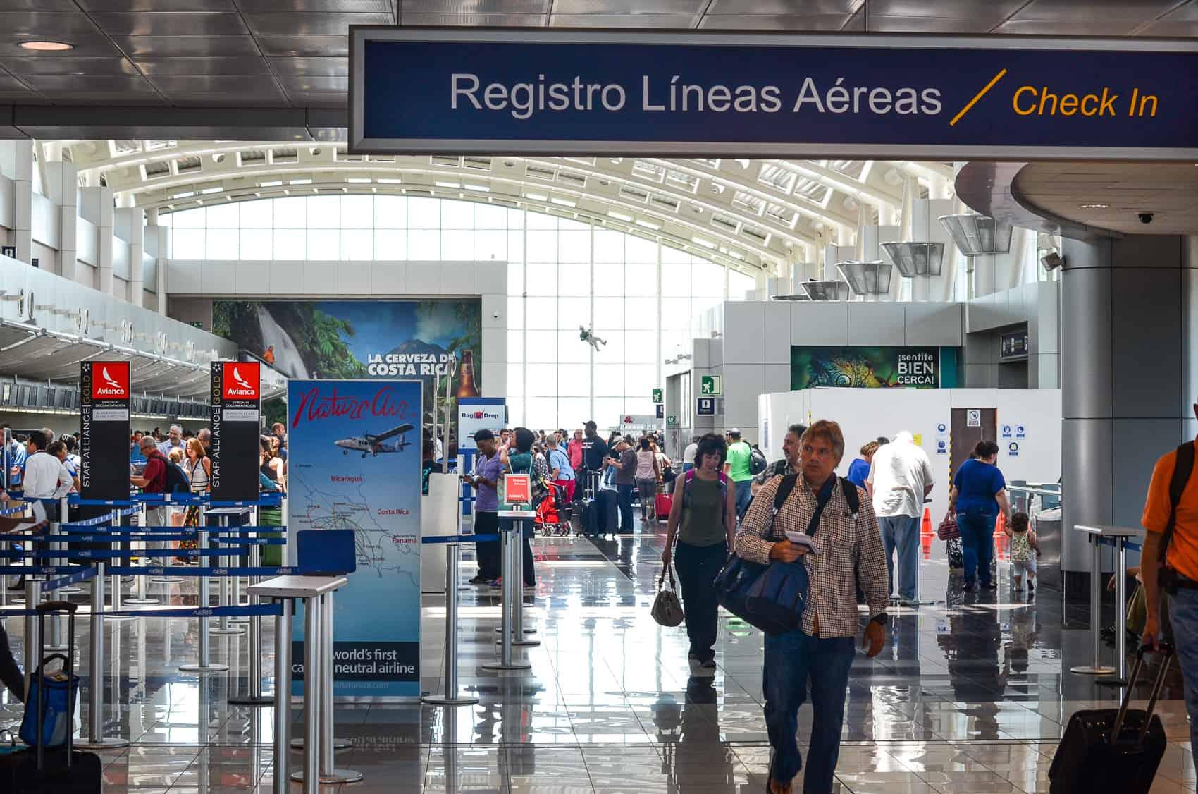 Travelers check in at Juan Santamaría International Airport in Alajuela.