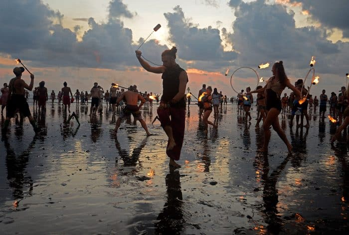 Fire dancers overtook the beach during the festival's last sunset ceremony on Sunday.