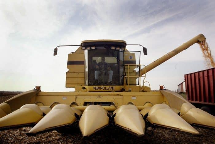 An Illinois farmer unloads a combine of corn.