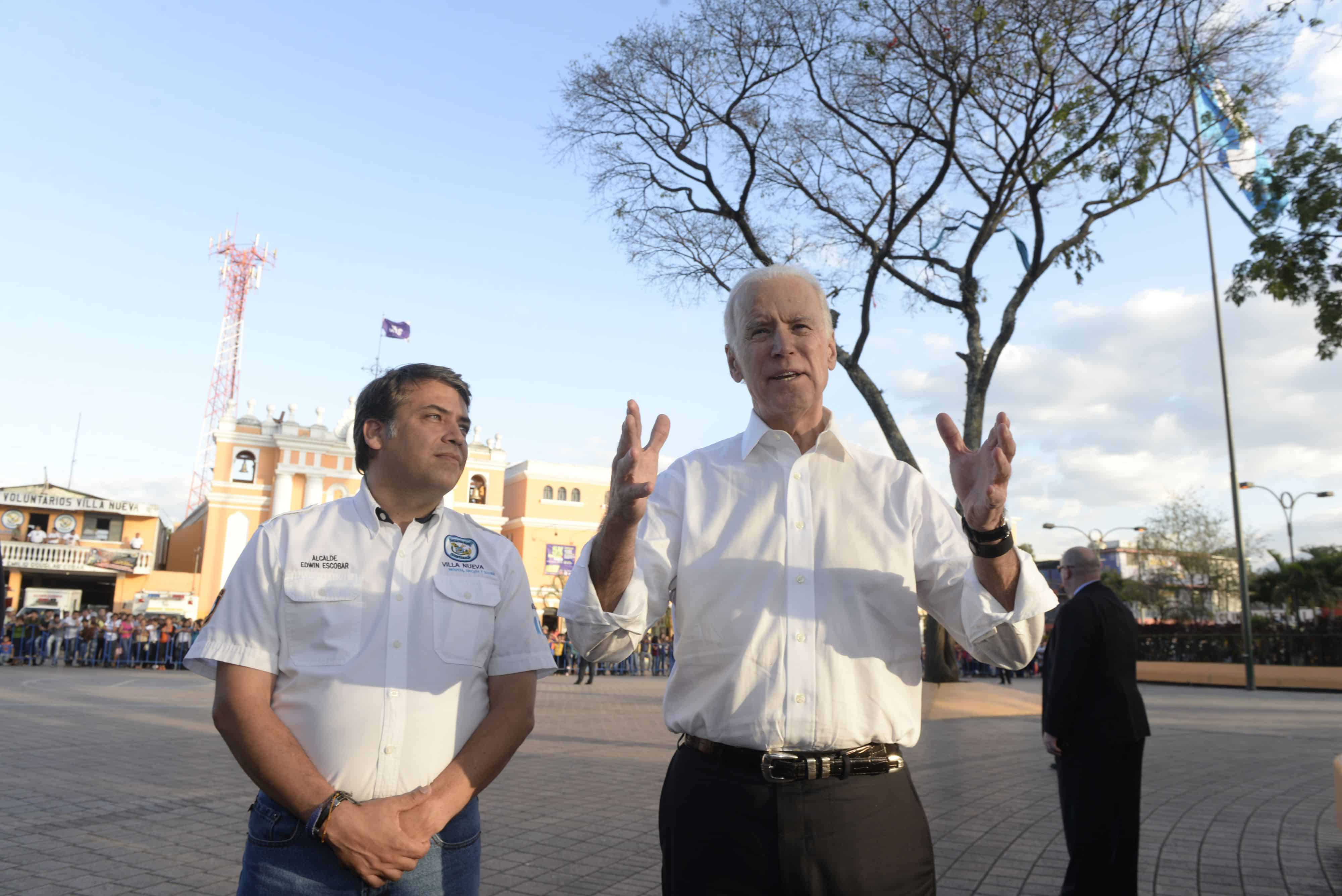 U.S. Vice-President Joe Biden (R) speaks with Edwin Escobar (L), the mayor of Villa Nueva, a suburb outside of Guatemala City, on March 3, 2015.