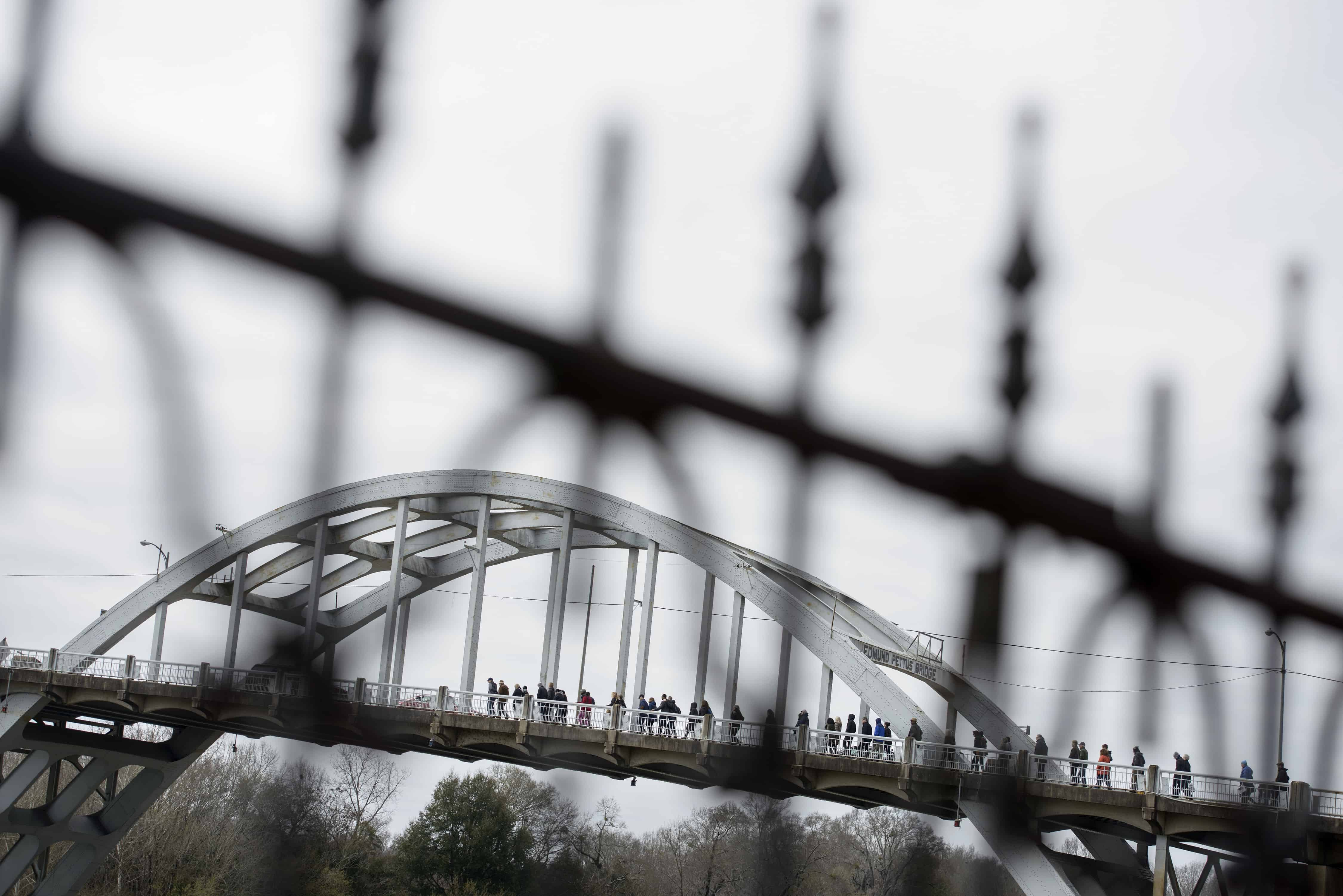 People walk towards the Edmund Pettus Bridge on March 6, 2015 in Selma, Alabama. March 7 will mark the 50th anniversary of Bloody Sunday when civil rights marchers attempting to walk to the Alabama capital of Montgomery for voters' rights clashed with police. The march from Selma to Montgomery was part of the plight to end voting discrimination against African Americans.