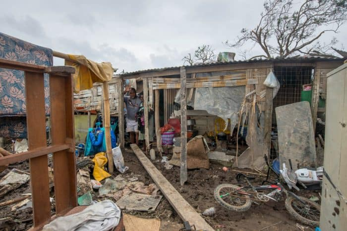 "This handout photo taken and received on March 15, 2015 by UNICEF Pacific shows a resident's home badly damaged by Cyclone Pam, outside the Vanuatu capital of Port Vila. Cyclone-devastated Vanuatu declared a state of emergency on March 15 as relief agencies scrambled to get help to the remote Pacific nation amid reports entire villages were ""blown away"" when the monster storm swept through."