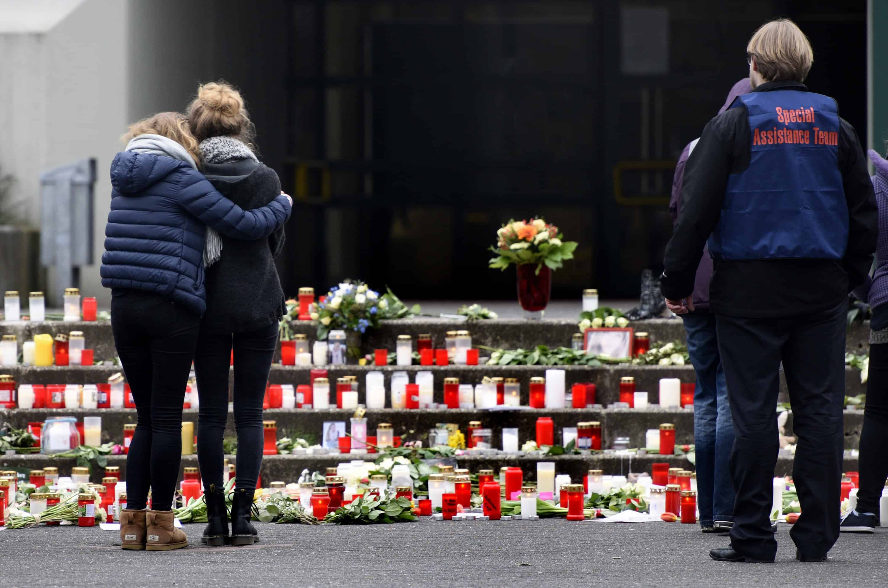 Students gather in front of memorial of flowers and candles at the Joseph-Koenig-Gymnasium secondary school in Haltern am See, western Germany on March 25, 2015. Sixteen German teenagers and two teachers on a school exchange trip were assumed to be among the 150 dead in the crash of a passenger jet in the French Alps, officials said.