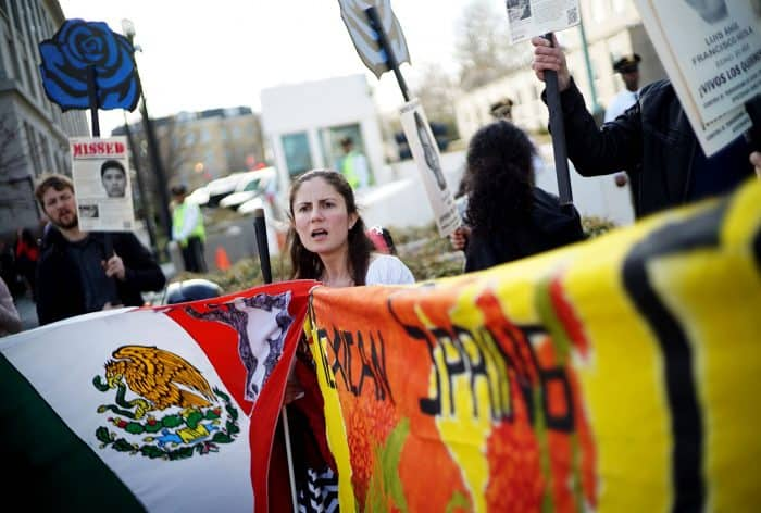Demonstrators take part in a protest against the government of Mexico across from the State Department on March 26, 2015 in Washington, DC. The protesters are demanding justice for the 43 missing students from Ayotzinapa, Mexico.