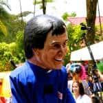 A busker wears a mask of Franklin Chang Díaz, legendary Costa Rican astronaut.
