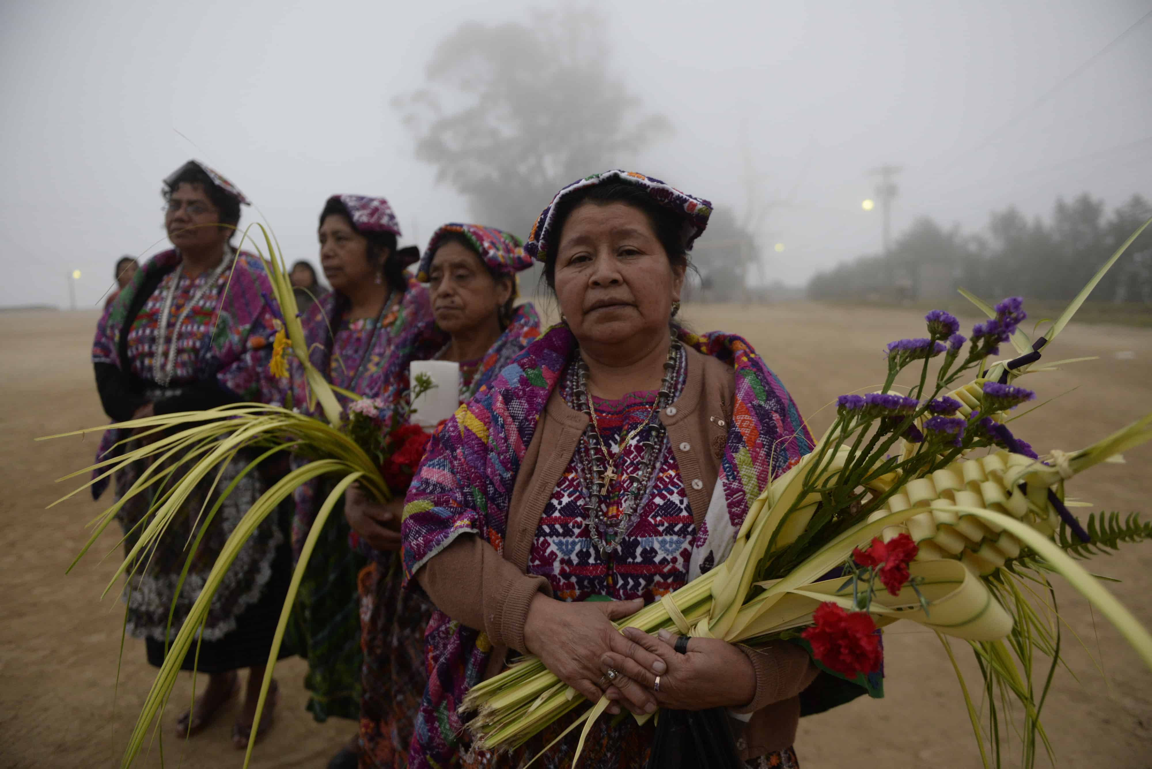Catholic faithful prepare to start the Palm Sunday procession on March 29, 2015 in San Pedro Sacatepequez, 30 km west of Guatemala City.