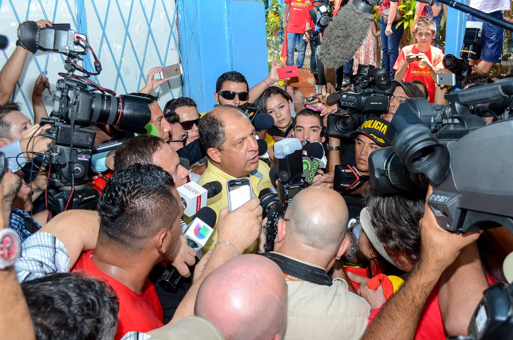 Then-candidate Luis Guillermo Solís addresses a more friendly media after casting his ballot.