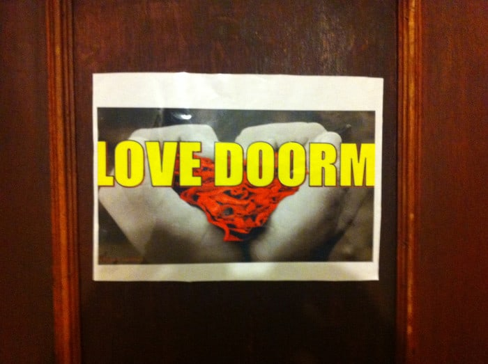 """Love Doorm,"" A sign on the door at the Costa Rica Love Hostel."