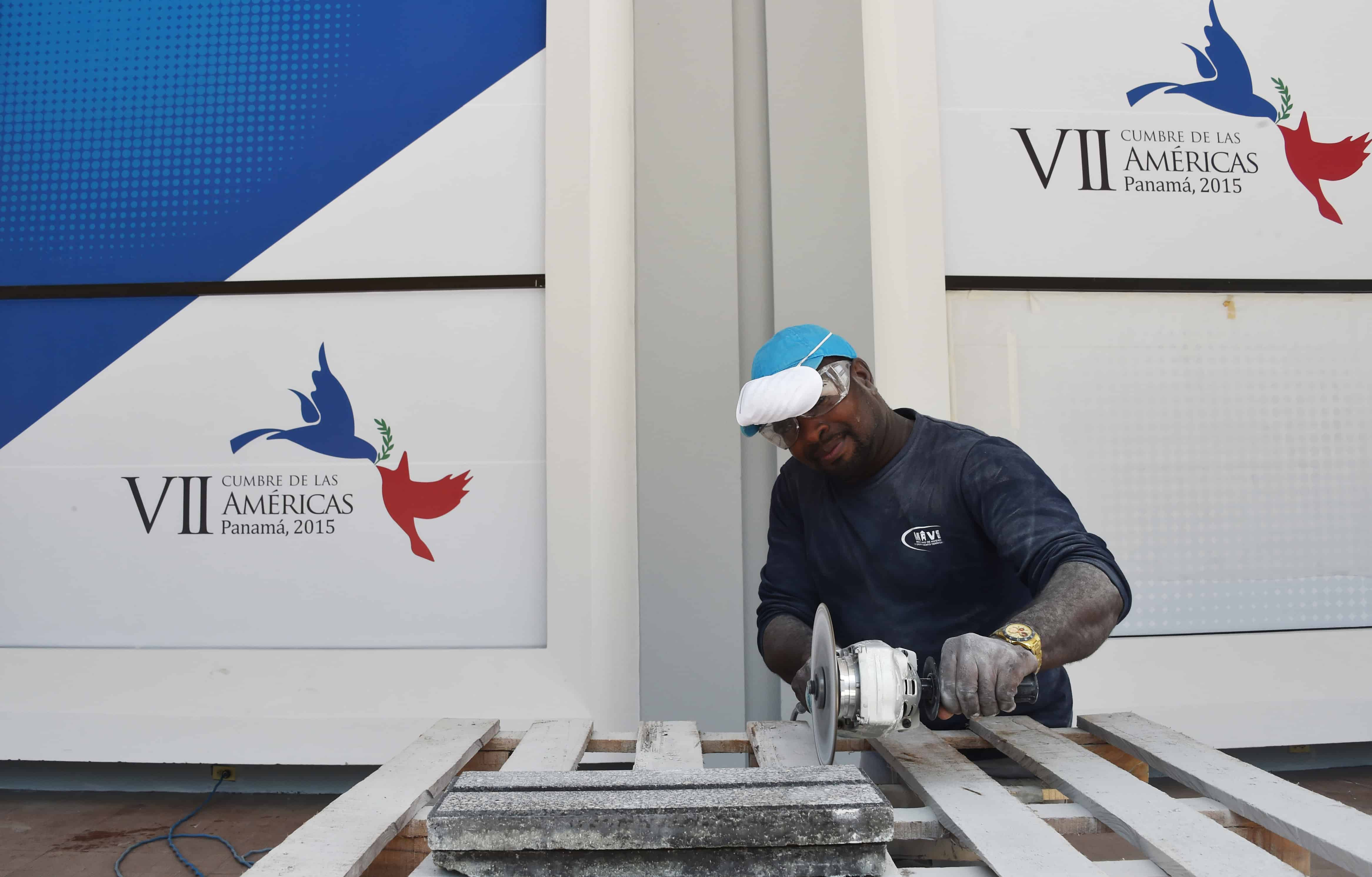 A worker at the Atlapa Convention Center gets ready for the upcoming VII Summit of the Americas, in Panama City.