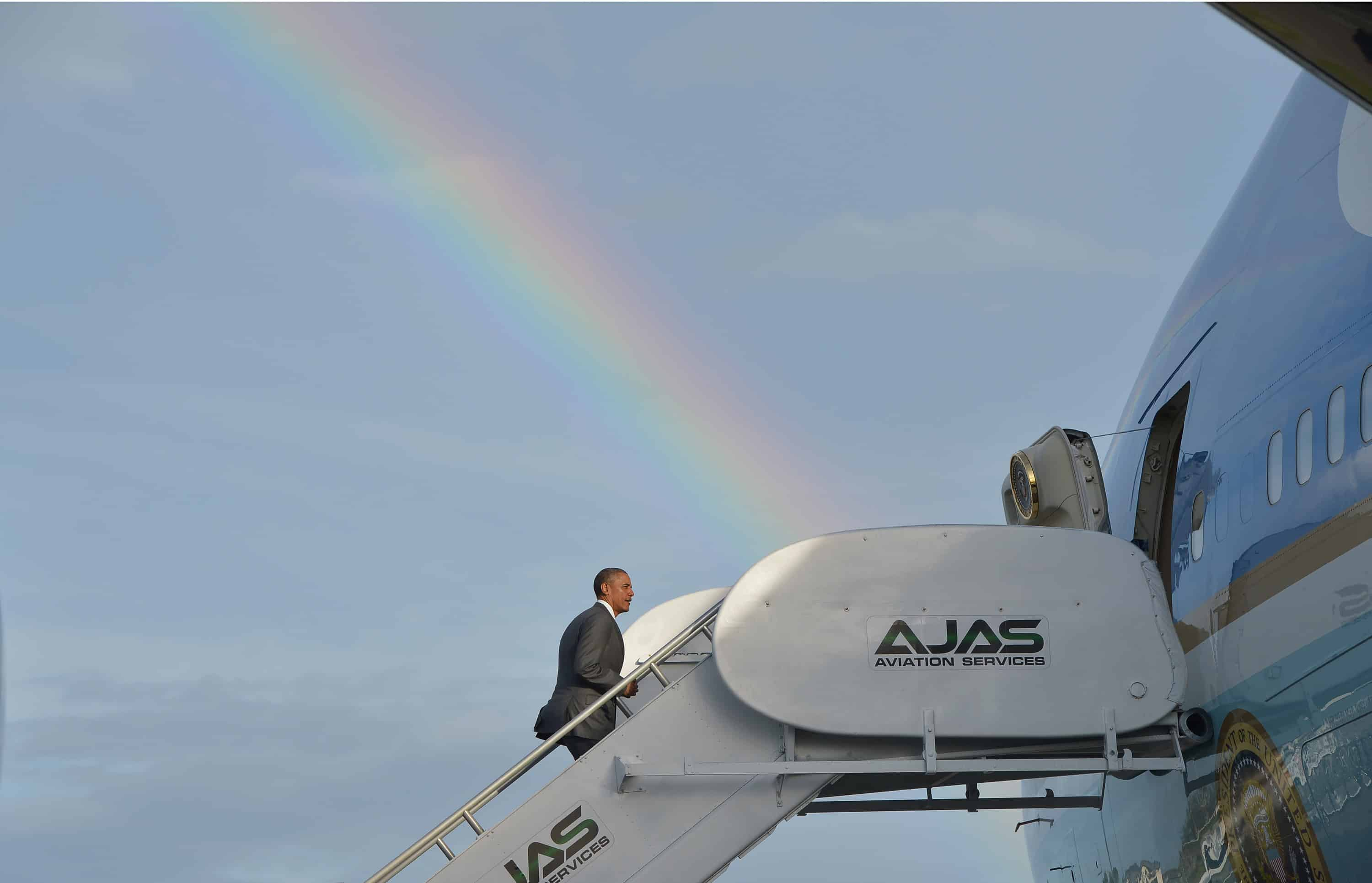 U.S. President Barack Obama boards Air Force One under a rainbow while departing from Kingston, Jamaica.